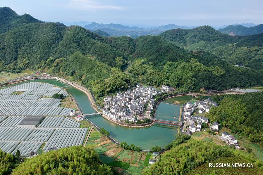 """Деревня Сяцзян в провинции Чжэцзян -- путь """"зеленого"""" развития"""