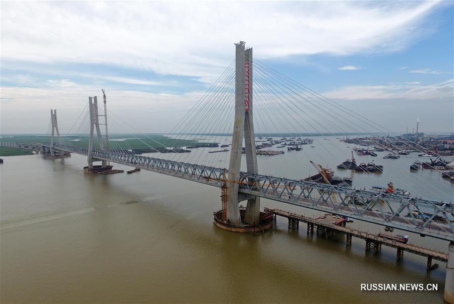 """В провинции Хунань достроили мост железной дороги """"Мэнхуа"""" через озеро Дунтинху"""