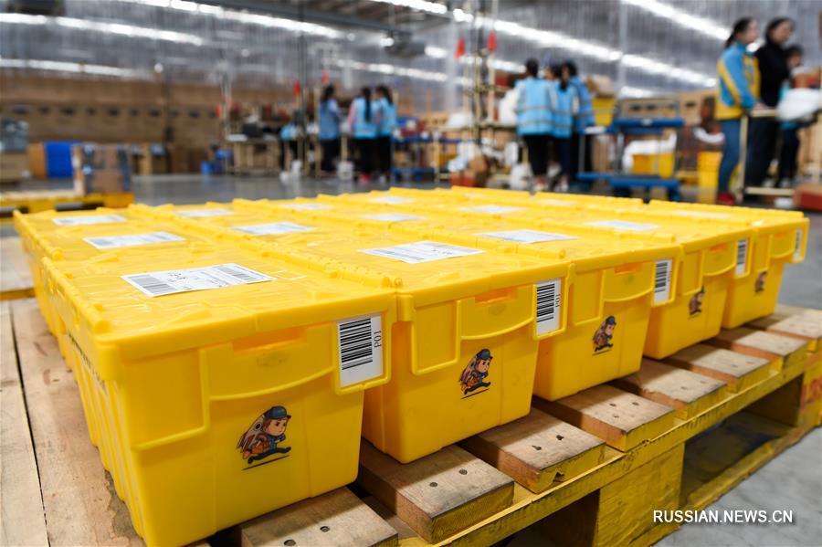 """Удобно и экологично -- """"коробки экспресс-доставки"""" замещают бумажные аналоги в Китае"""