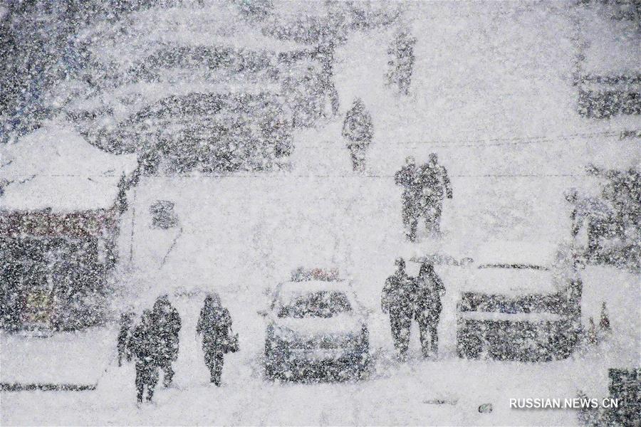 В городе Яньтай выпал снег
