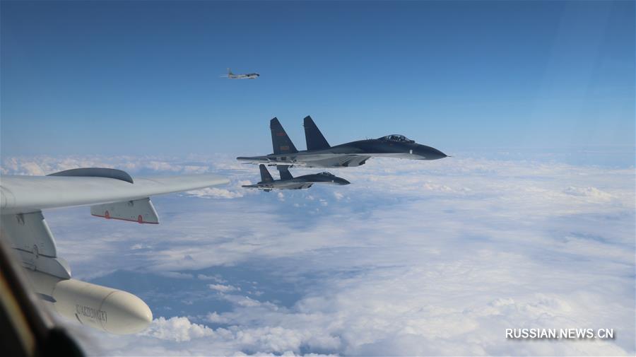 Очередные тренировочные полеты китайских военных самолетов над открытым морем