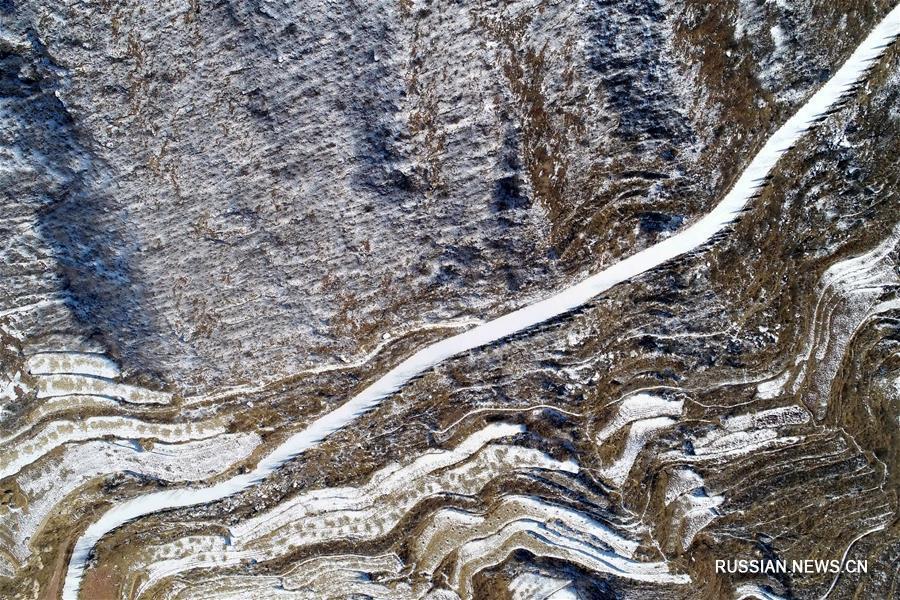 Снег на террасных полях в Шахэ