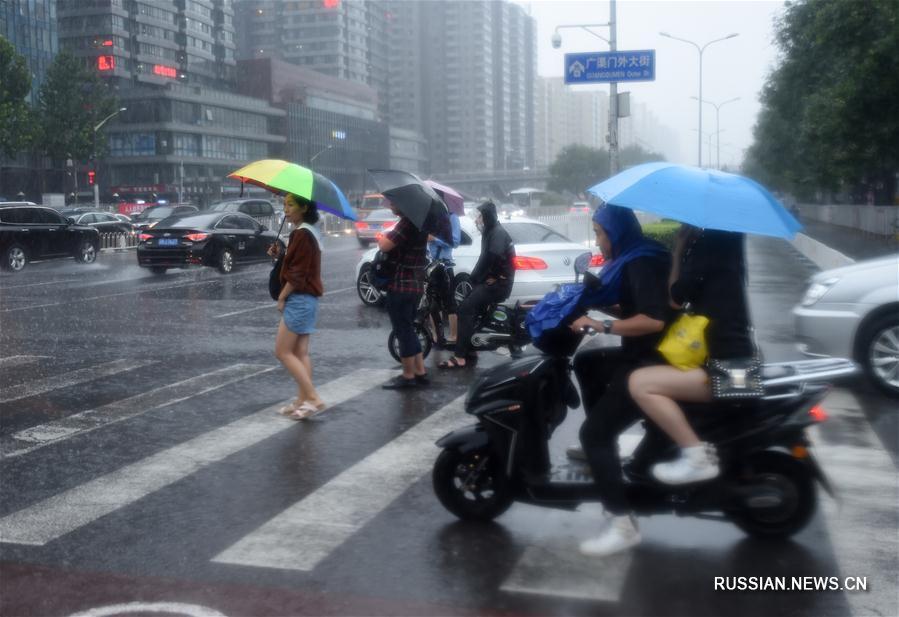 Сильный дождь в Пекине