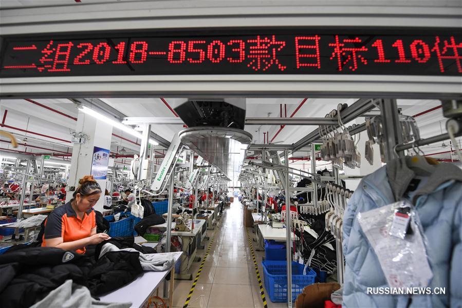 Производство детской одежды в поселке Чжили провинции Чжэцзян