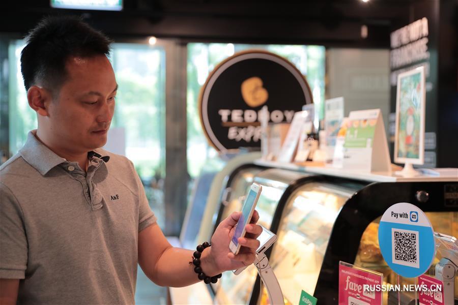 Китайские технологии помогают Малайзии расширять сферу мобильных платежей