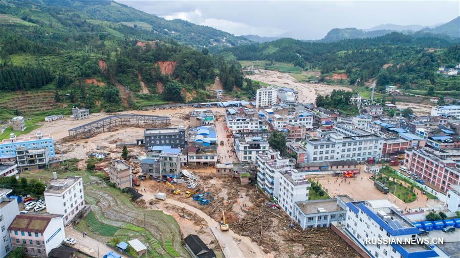 Интенсивно идет поисково-спасательная операция в пострадавшем от наводнения районе провинции Юньнань