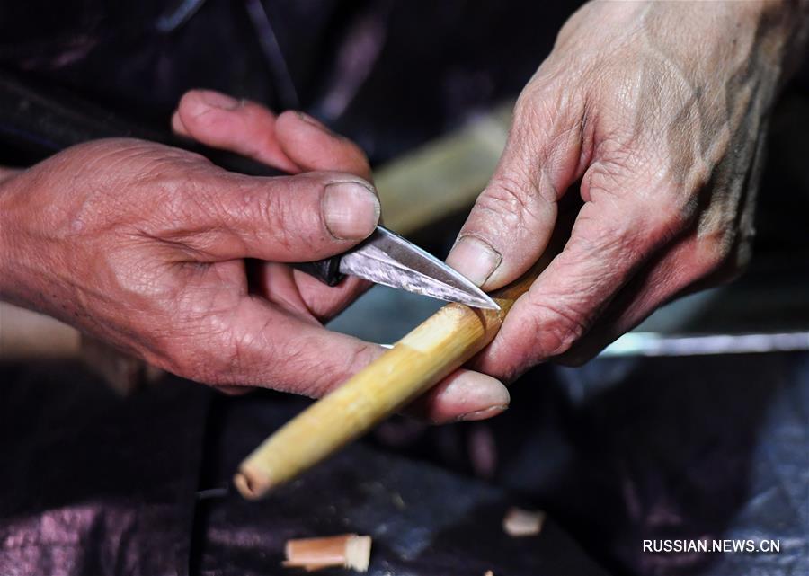 Лушэн -- традиционный китайский духовой музыкальный инструмент