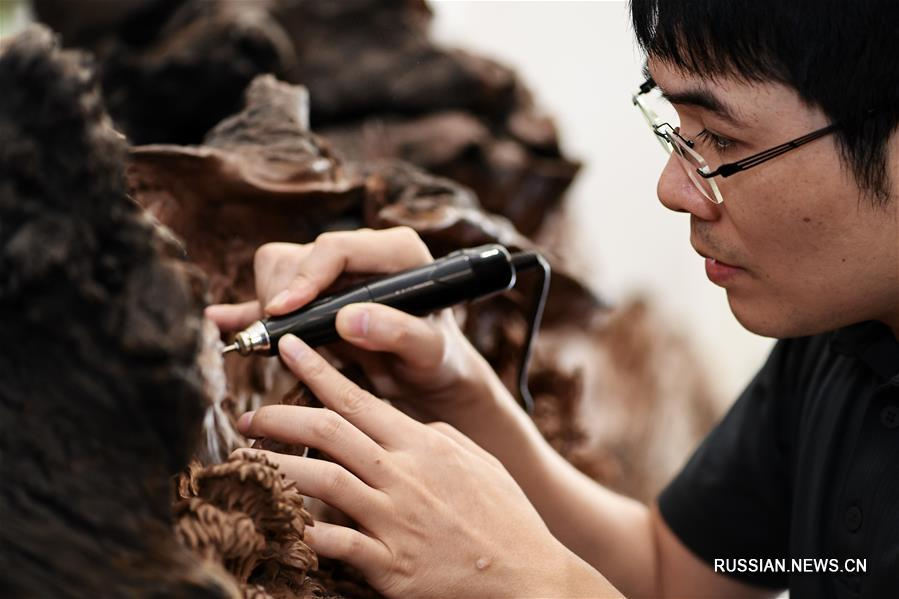 Резьба по дереву из городского округа Путянь на юго-востоке Китая