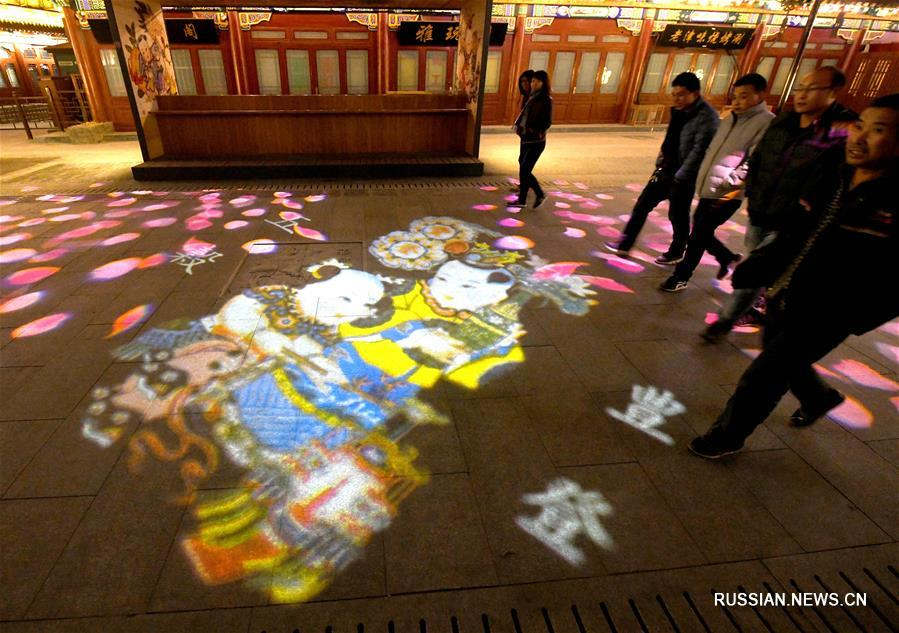 Световое шоу новогодних лубочных картин в древнем городке Янлюцин