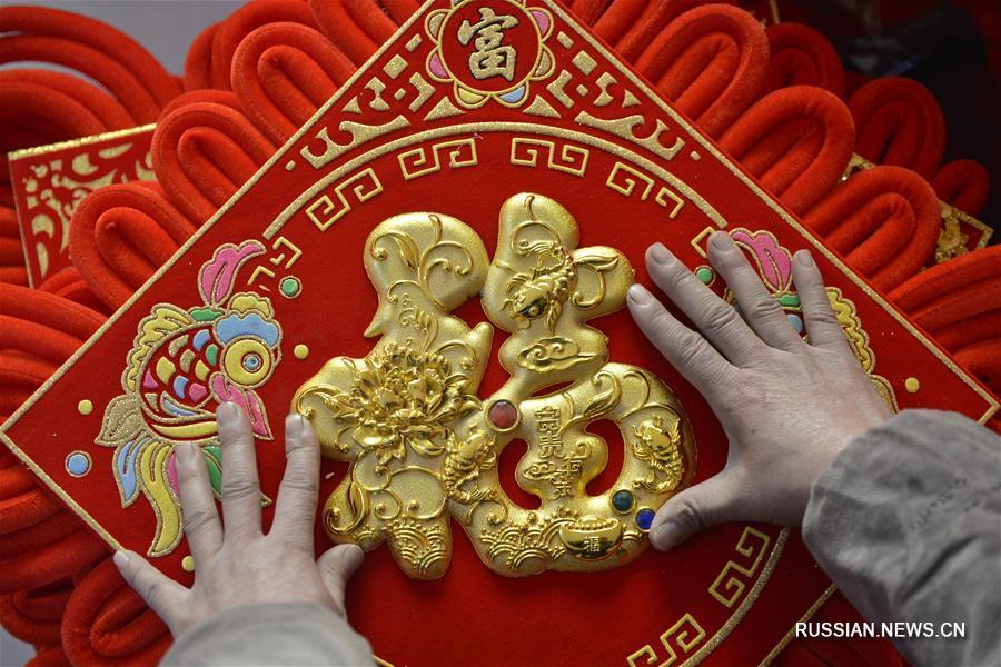 Красный узелок на счастье -- Китай готовится к празднику Весны