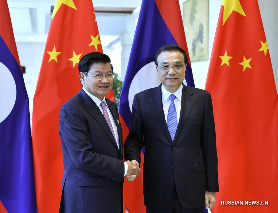 Ли Кэцян встретился с премьер-министром Лаоса Тхонглуном Сисулитом