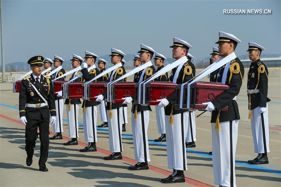 Церемония передачи шестой группы останков китайских добровольцев, павших в Корейской войне