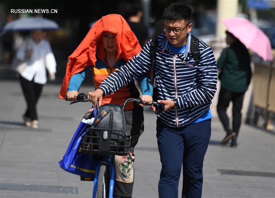 """В Пекине из-за знойной жары объявлено """"желтое"""" предупреждение"""