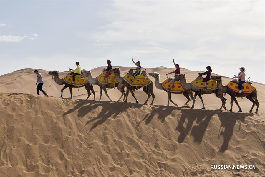 Синьцзян: в пустыне наступил туристический сезон