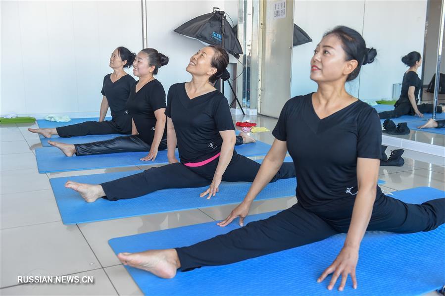 Здоровье нации -- Китайский коллектив шестидесятилетних танцовщиц на шесте