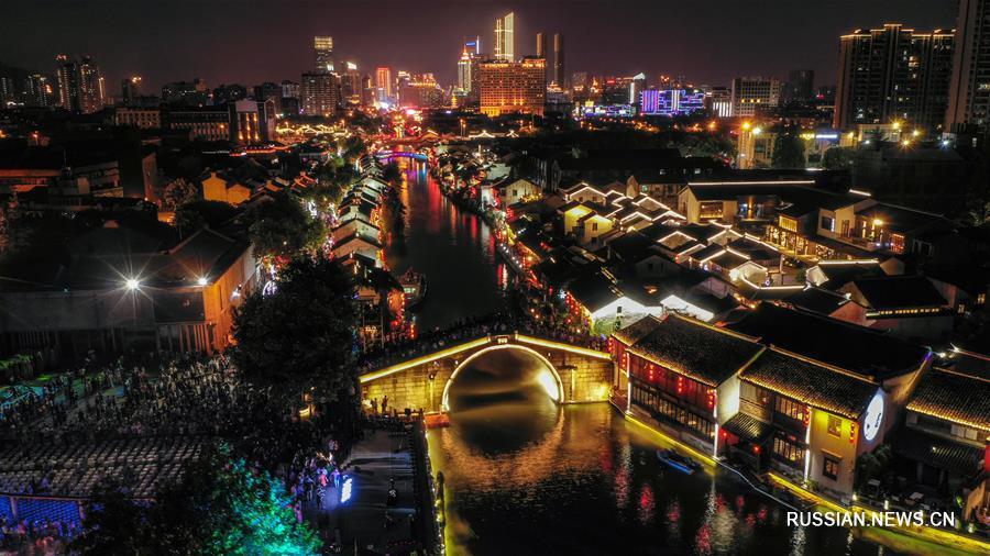 Развитие ночной экономики на туристическом канале в Уси