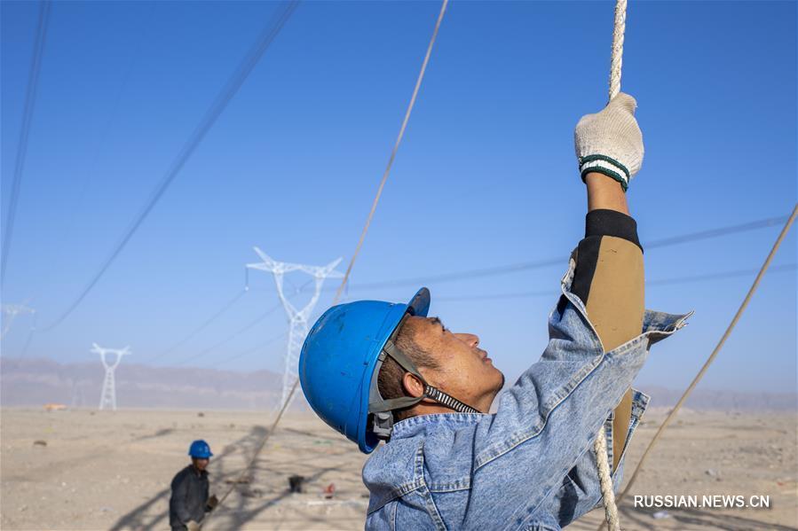 В Синьцзяне продолжается строительство ЛЭП Куча -- Аксу -- Бачу