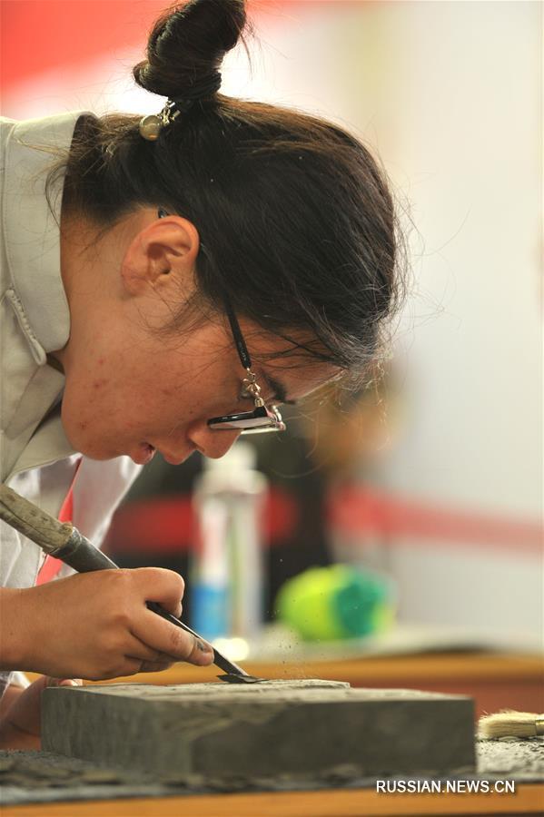 Китайские мастера резьбы по кирпичу собрались в Линься