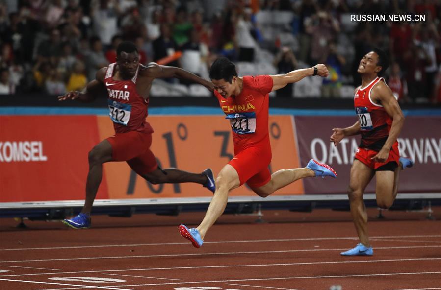 """18-е Азиатские игры -- Китайский """"летающий спринтер"""" Су Бинтянь -- новый король на 100-метровой дистанции в Азии"""
