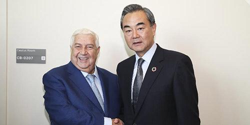 Ван И встретился с главой МИД Сирии Валидом аль-Муаллемом