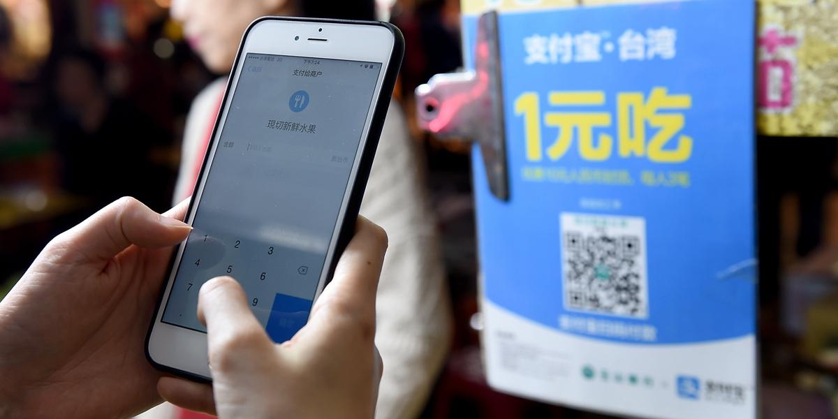На Тайване все шире применяются мобильные платежные приложения из материкового Китая